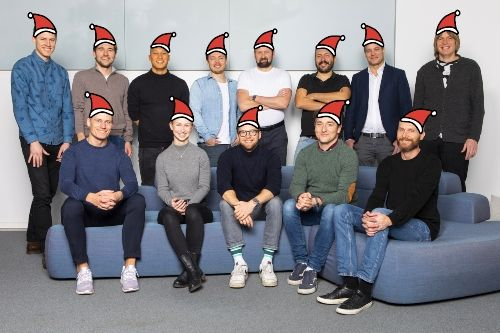 The Unloc team with drawn on santa hats