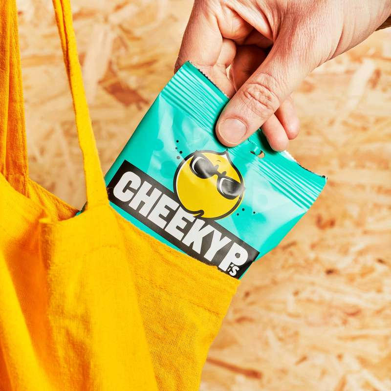 Pulling a pack of Cheeky P's from a yellow tote bag