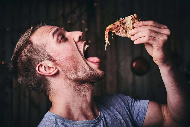 Dropping Pizza into mouth