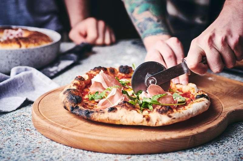 Slicing Dough & Glory pizza