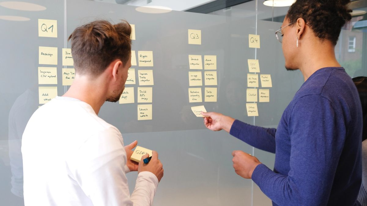 2 people on a wireframing board