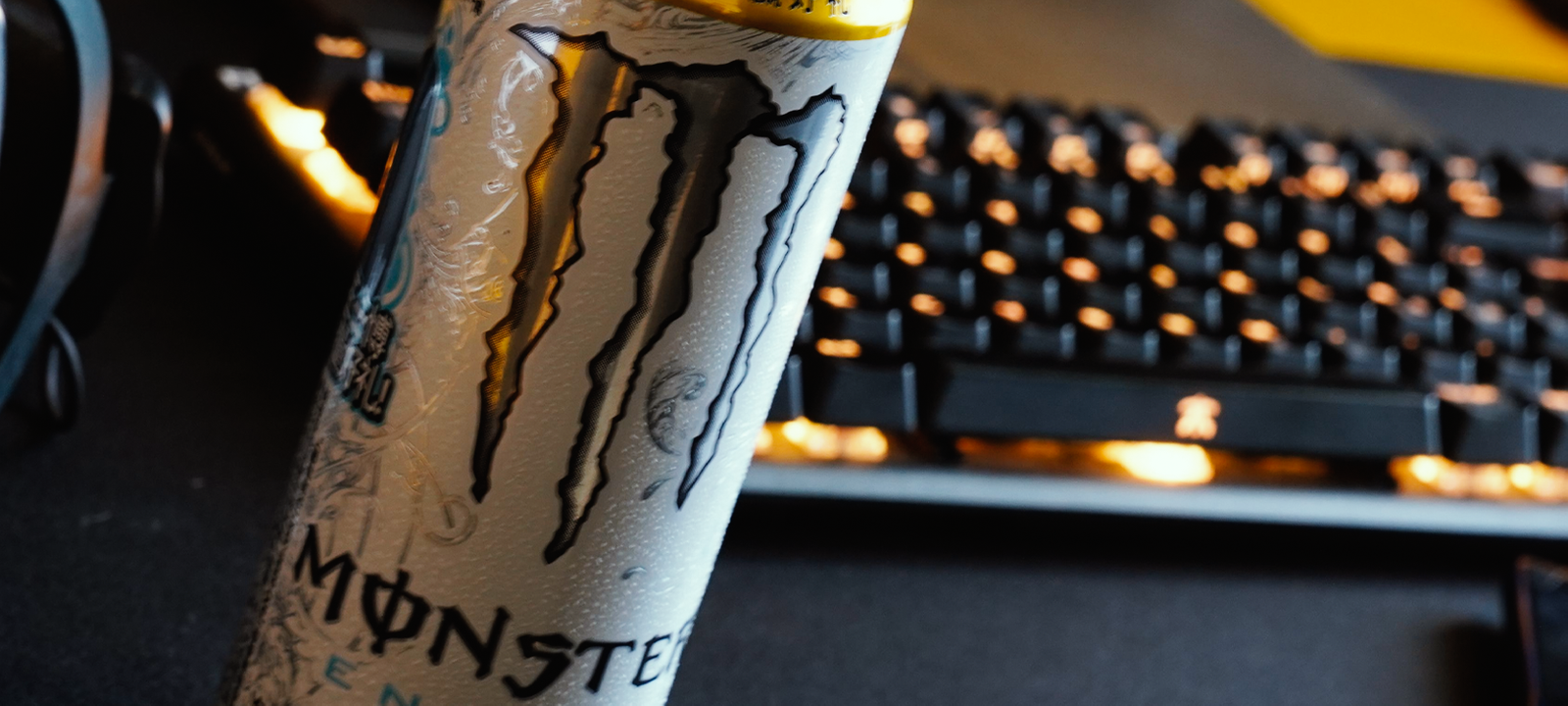Can of monster by a Fnatic keyboard