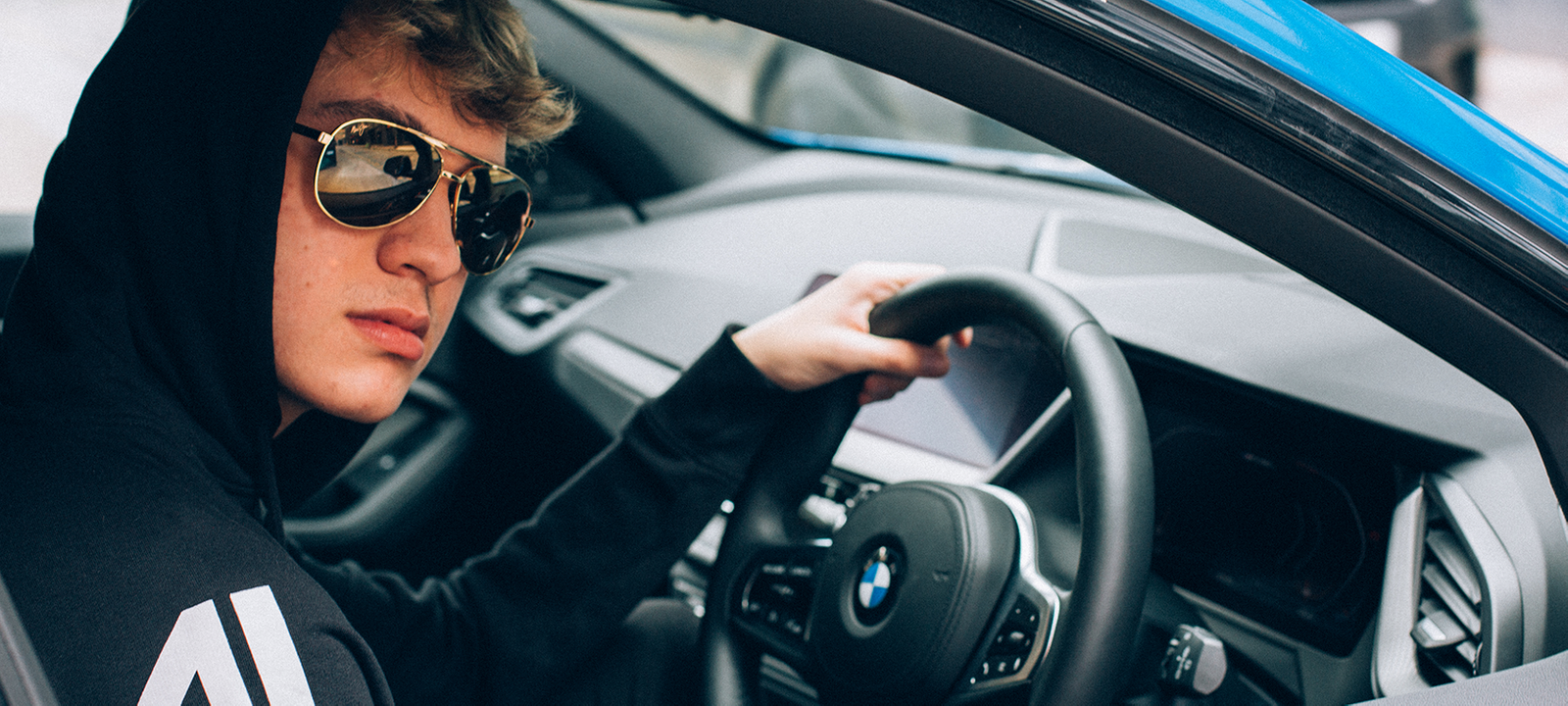 Player in a BMW car