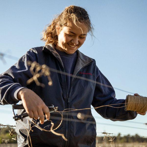 vineyard worker smiling