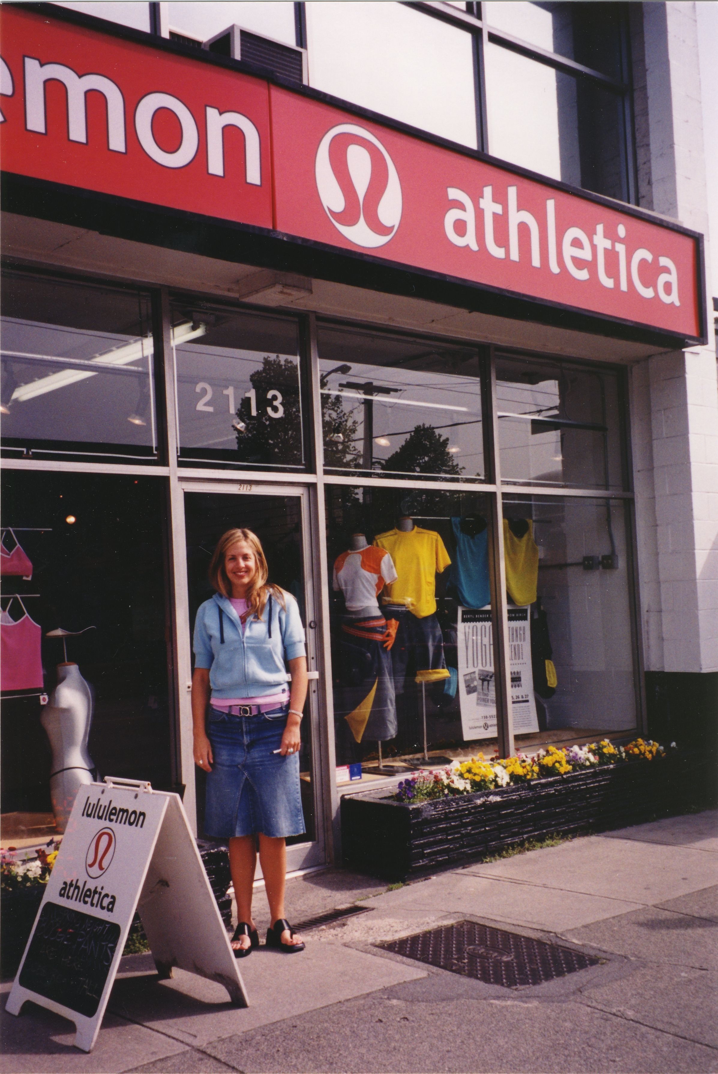 """My future wife """"Summer"""" as the lululemon designer standing in front of our 2nd store across the street from the 1st store, 2001"""