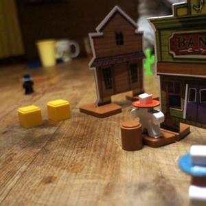 Stróże prawa bronią banku przed czyhającymi w tle bandytami. (Flick 'em Up!)