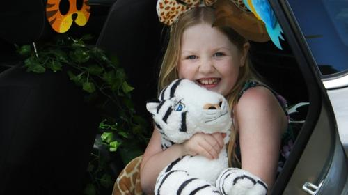 Alyna hugging a stuffed animal