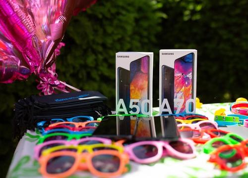 A party table with sunglasses and Samsung phones