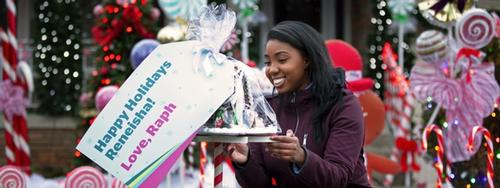 Reneisha holding a giant platter with a card that reads