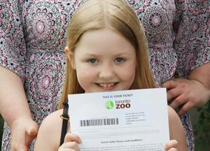 Alyna holding a zoo ticket