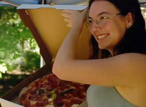 Hayley smiling with pizza