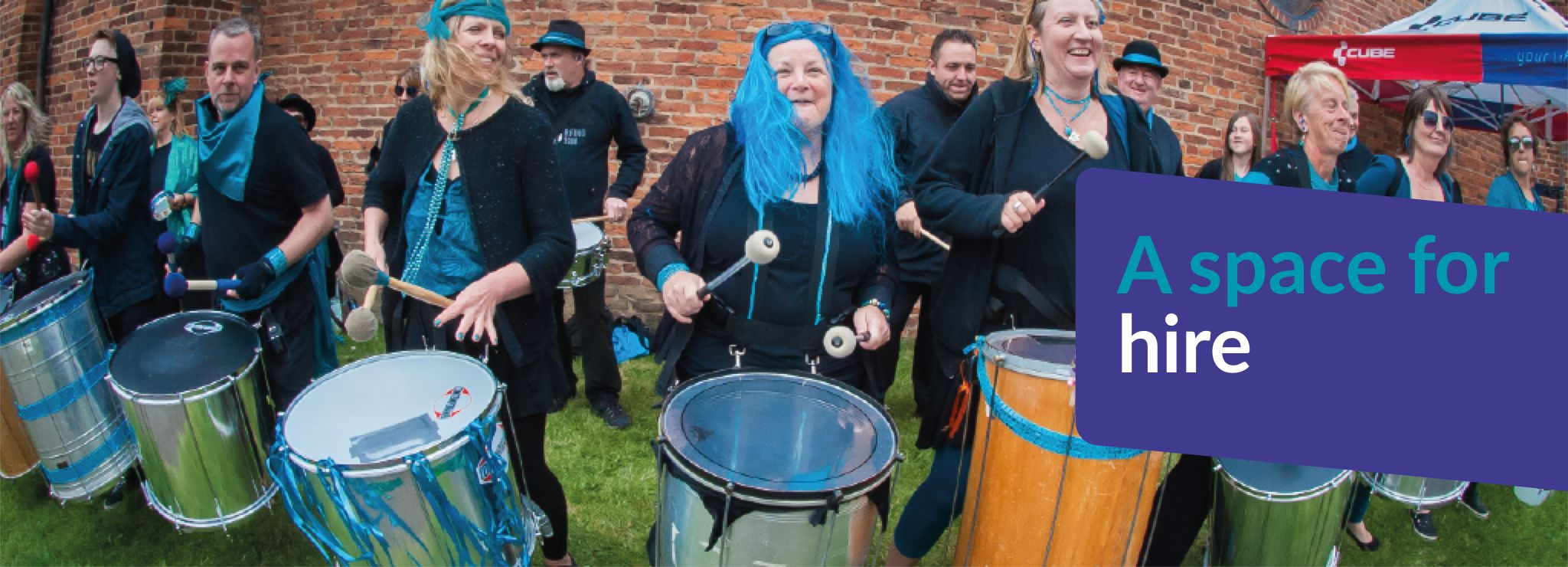 Text reads A space for hire - Image shows a drum outfit playing together
