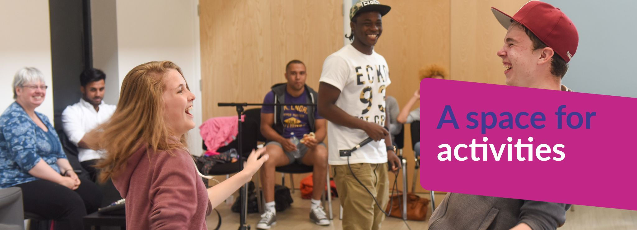 Text reads: A space for activities - image shows some young people performing some music together.