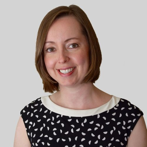 Smiling woman with short brown hair wearing a black and white dress | Dr. Allison Siebern, PhD | Proper's Head Sleep Science Advisor