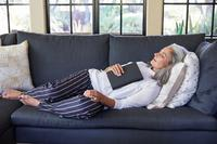 Woman sleeping on couch | menopause and sleep problems | Proper