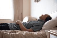 man sleeping with headphones on_best sleep podcasts_proper