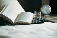 open book on bed_evening routine_sleep_proper