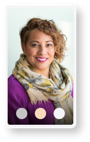 Smiling woman with curly hair, a purple shirt, and a scarf | Step two of Proper sleep coaching | Chat with your coach