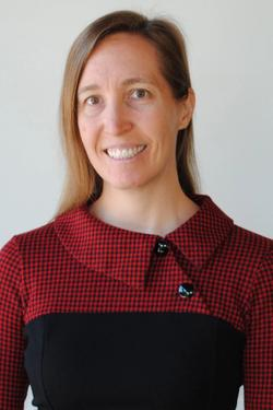 Smiling woman with brown hair wearing a red and black dress | Alice Hirschel, PhD | Proper's head supplement scientist