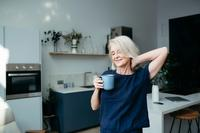 Older woman waking up drinking coffee_how long should sleep supplements take to begin working_Proper