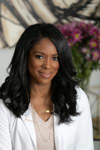 Female doctor in white lab coat | Dr. Jessica Shepherd | Proper
