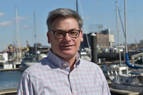 Smiling man with glasses standing on a pier | Michael T. Smith, PhD | Member of Proper's Scientific and Medical Advisory Council