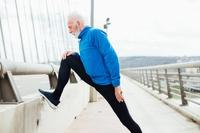 older man stretching on a run_sleep vs exercise weight loss_proper