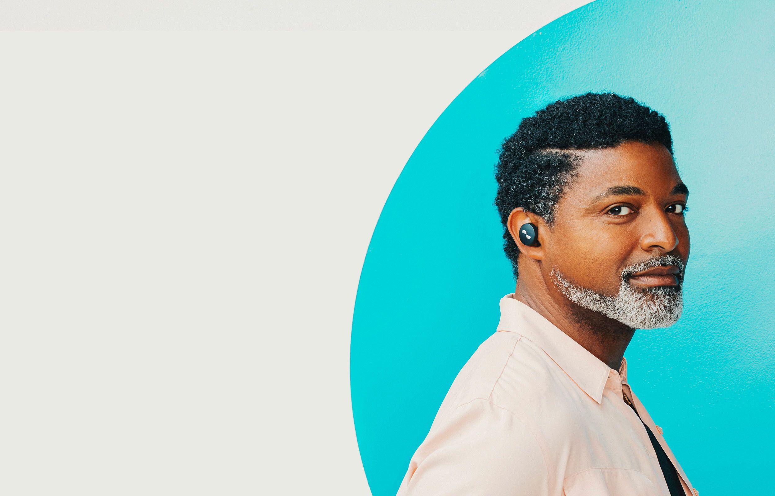 Person wearing NURATRUE earbuds in ears