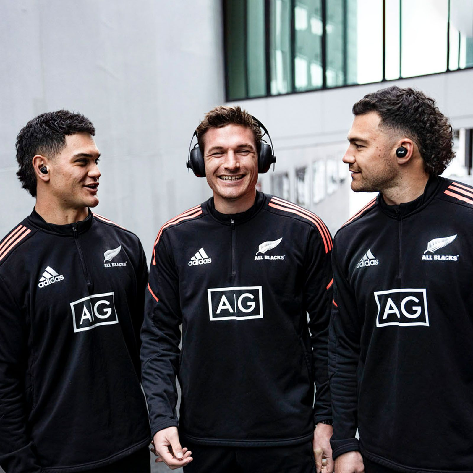 Three of the players from the New Zealand rugby team, All Blacks, wearing the NURABUDS earbuds, NURAPHONE headphones and NURATRUE earbuds