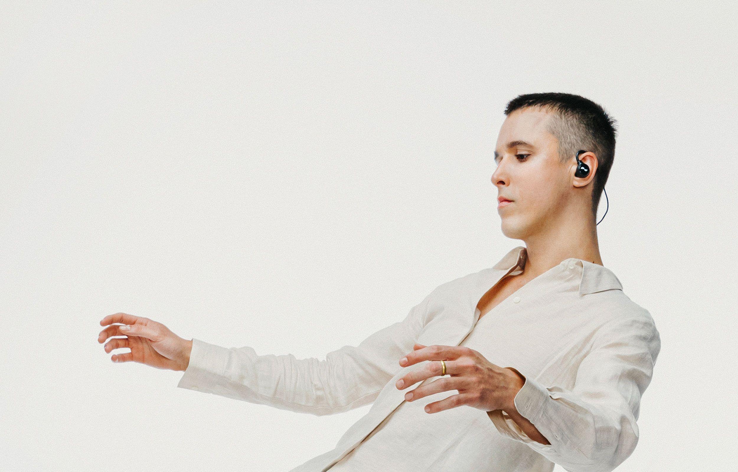 Person dancing with NURALOOP earbuds in ears