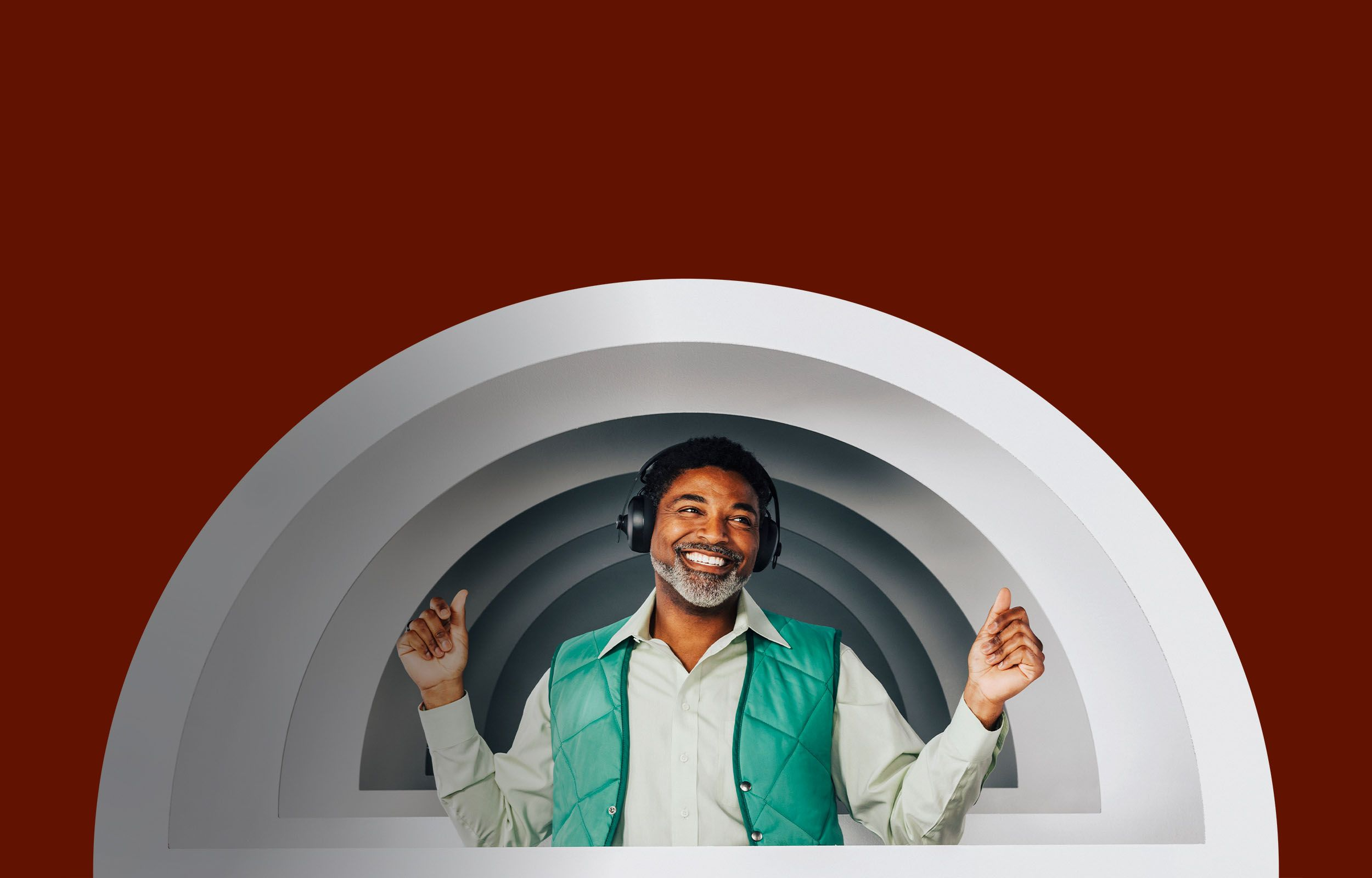 Person with NURAPHONE headphones on ears, dancing inside a Nura brandmark-inspired set