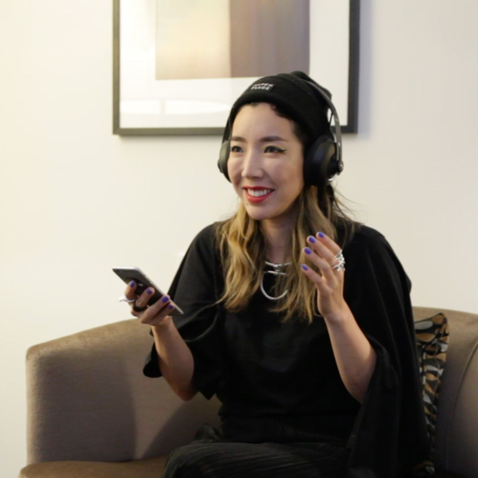 TOKiMONSTA, American record producer and DJ from Los Angeles, with NURAPHONE headphones on ears