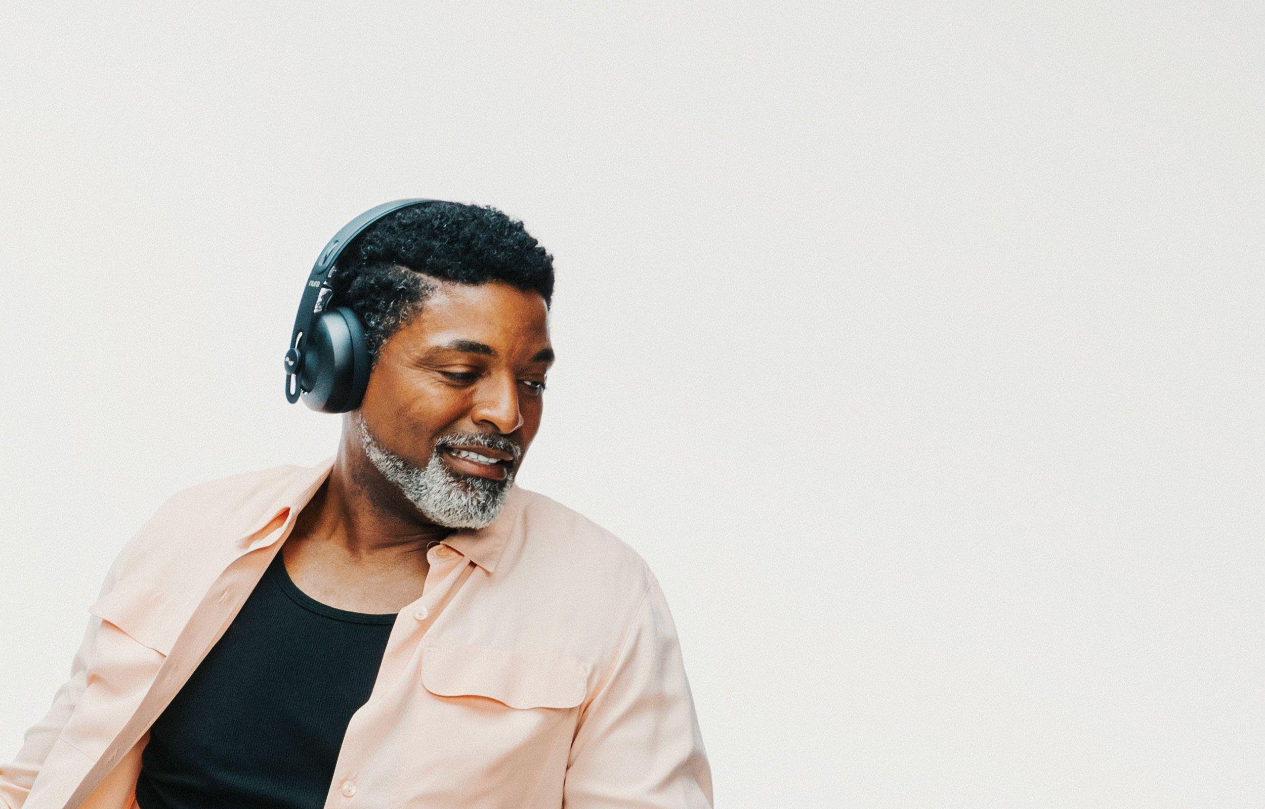 Person dancing with NURAPHONE headphones on ears