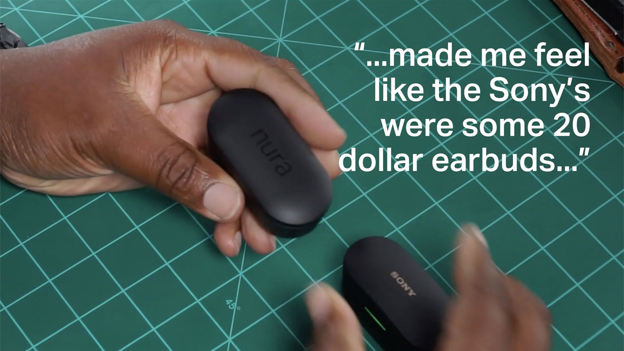 """Close-up shot of NURATRUE and Sony earbuds in their cases on a green cutting mat, accompanied by a quote by Antwan Richardson, """"...made me feel like the Sony's were some 20 dollar earbuds..."""""""