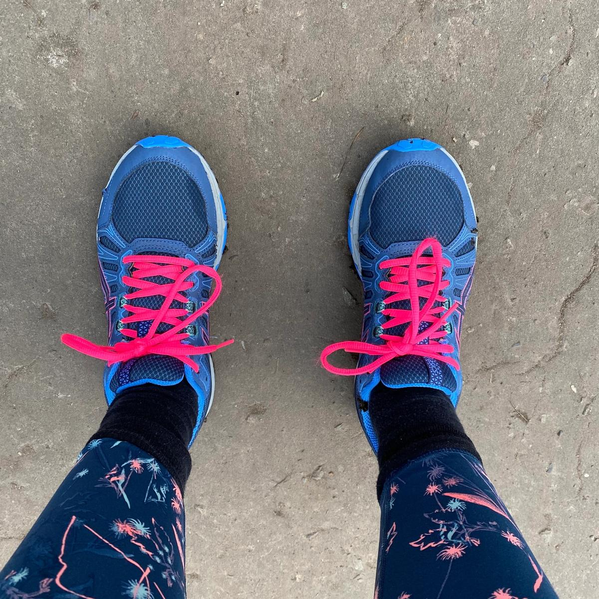 Pair of feet in running shoes from above