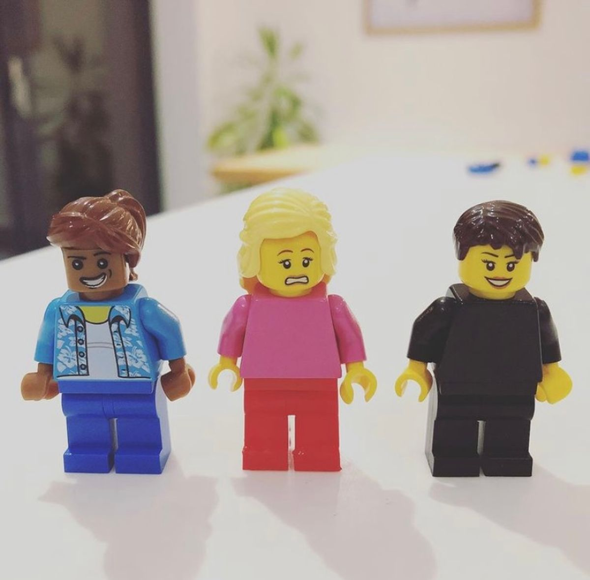 Three lego characters - one is looking worried