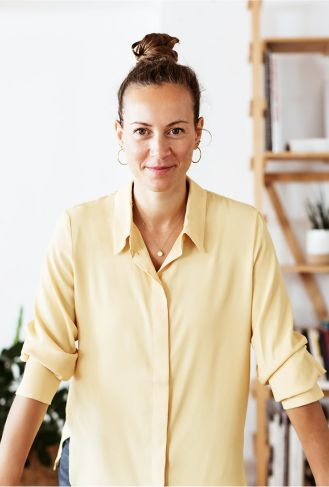 Woman standing in yellow shirt