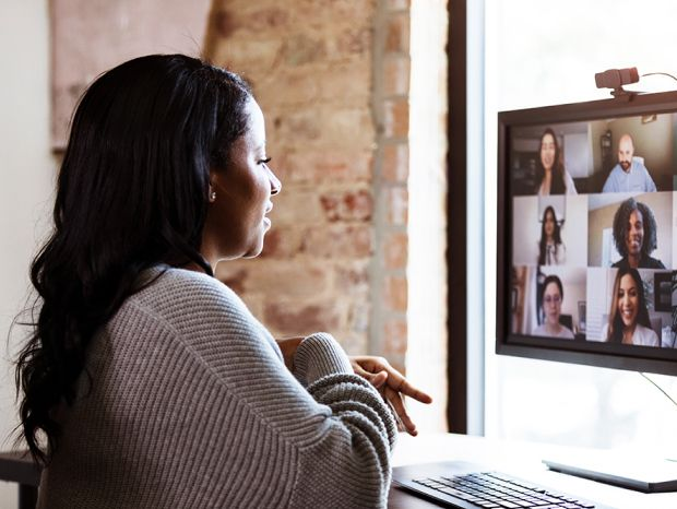 A woman speaking in a video call with other people
