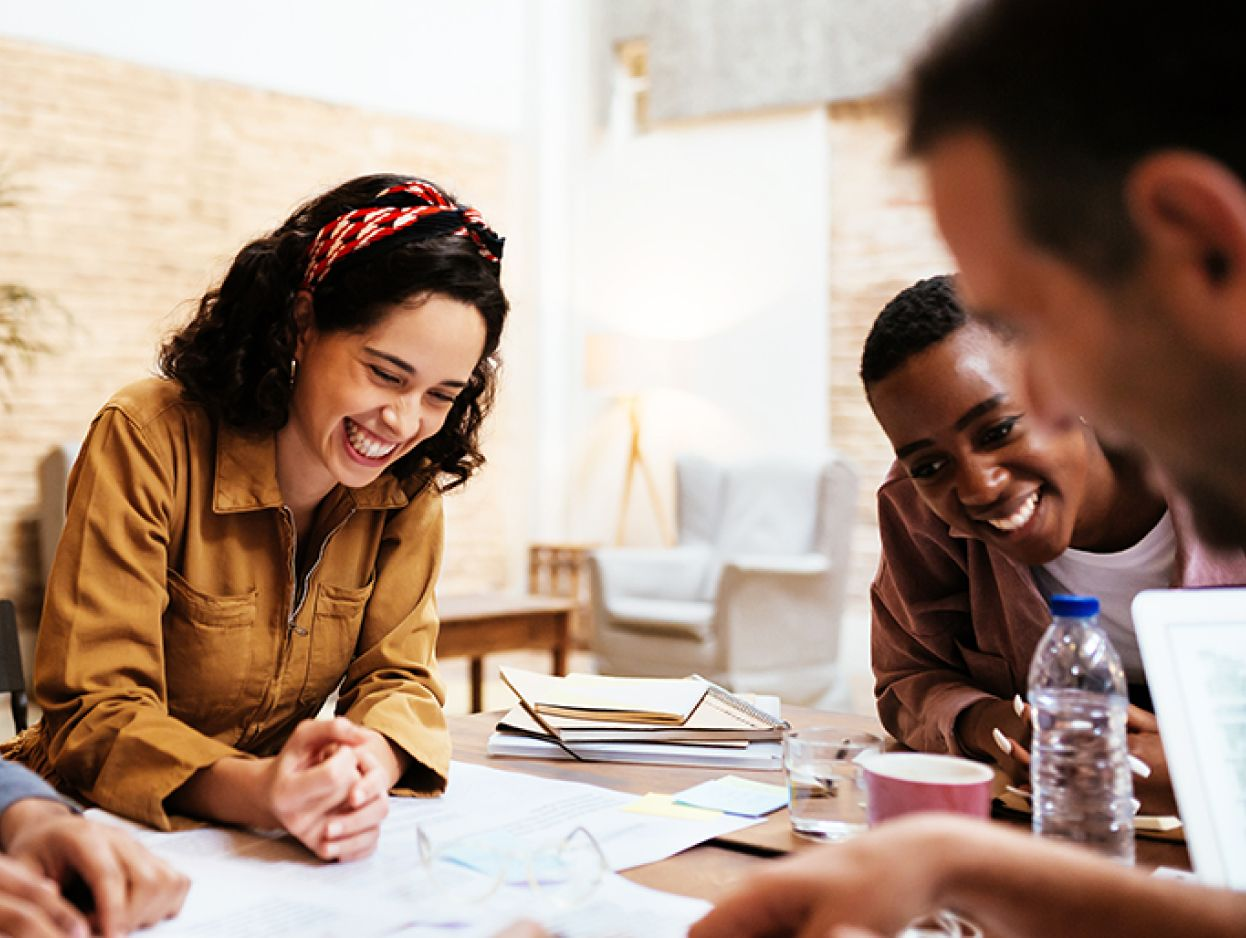 People in a meeting smiling