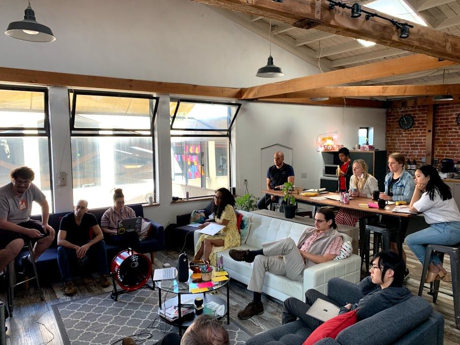 12 Elevate employees at a company meeting in the lounge at the Berkeley office