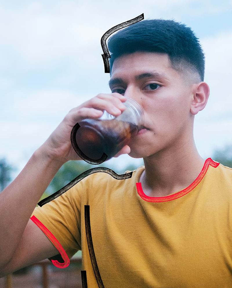 College student holding jar of cold brew.