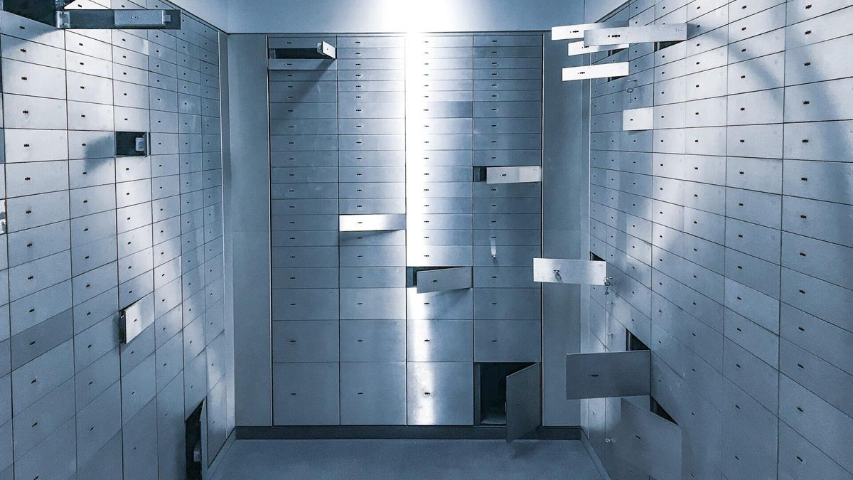 deposit boxes broken open, signifying insecure design