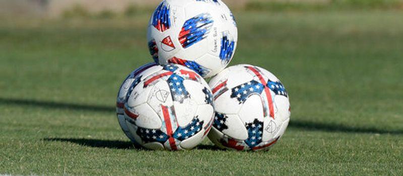 Photo of three footballs