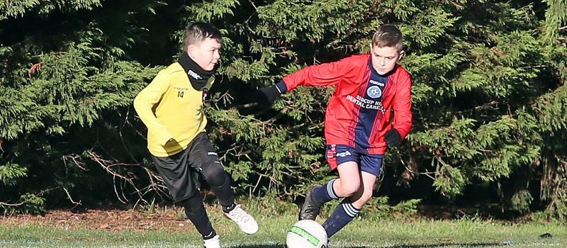 Photo of two players contesting the ball