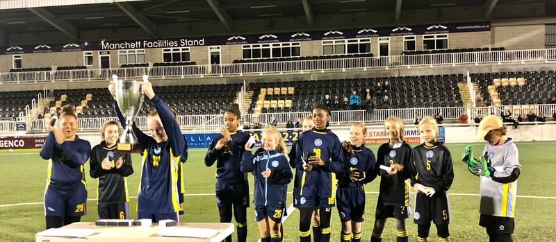 Photo of girls lifting cup