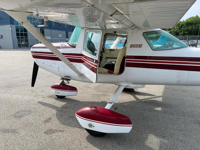 Aircraft parked on the ramp with the door open.
