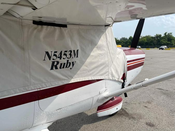 Aircraft parked on ramp with window covers installed.