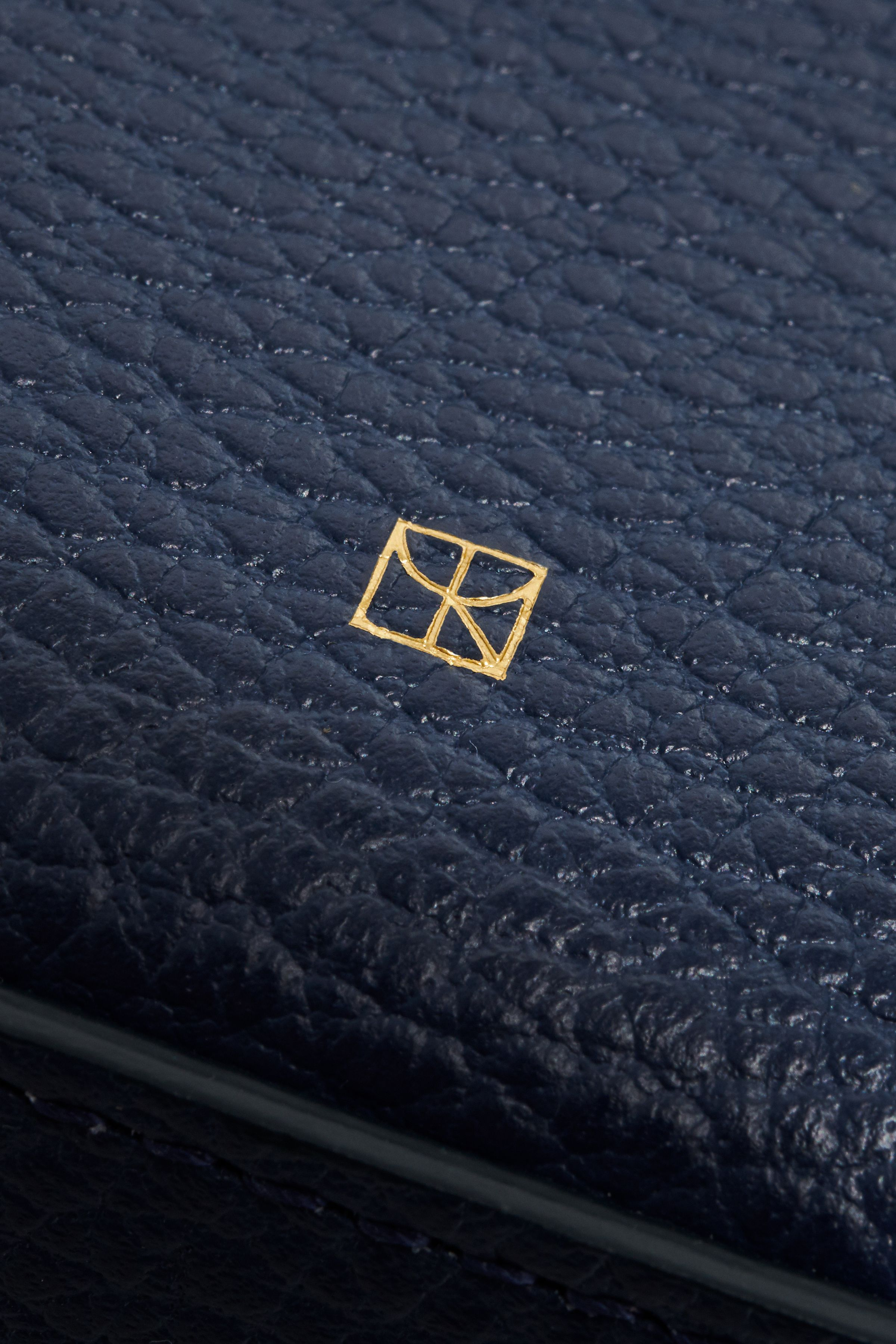 Yvonne Koné mark embossed into leather