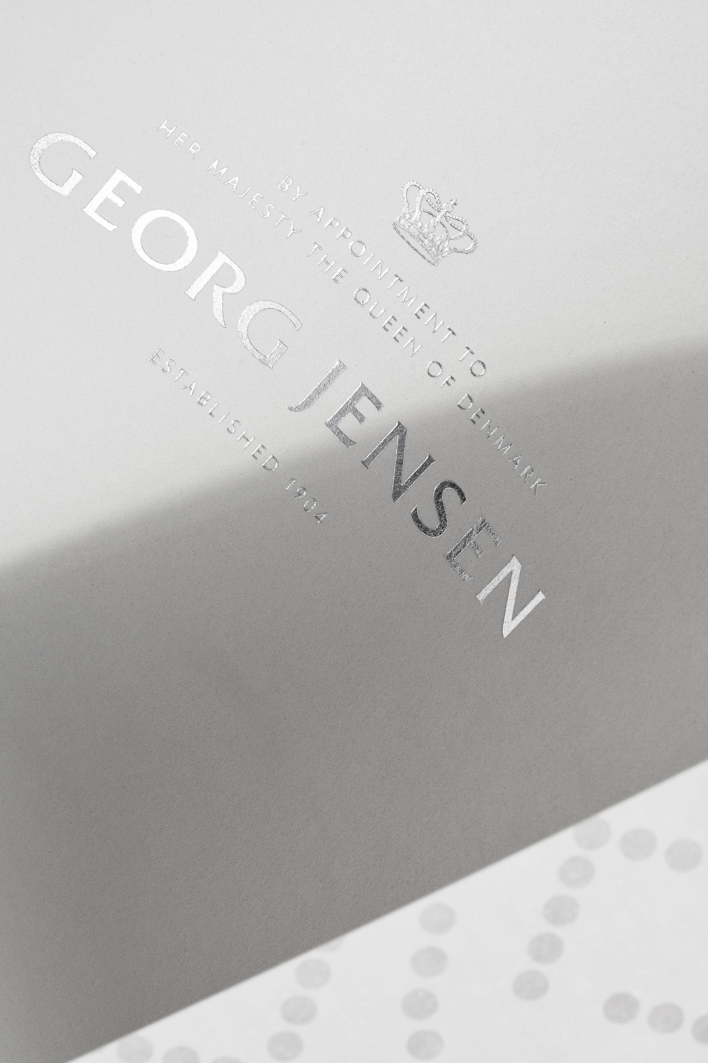 Georg Jensen logo in silver foil detail