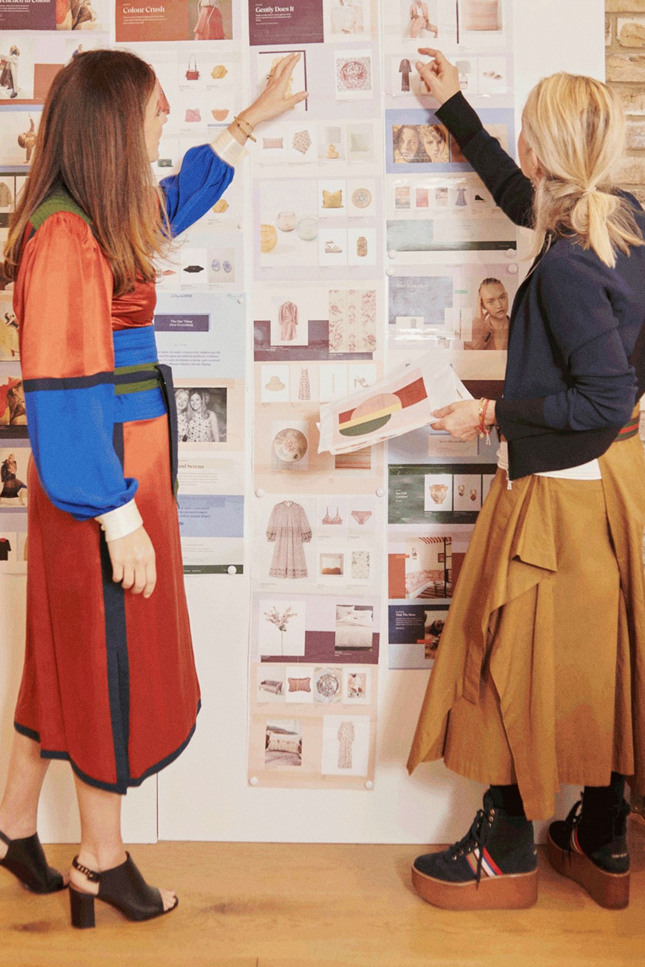 Collagerie founders Serena Hood and Lucinda Chambers working on a moodboard. Photograph by Eva Schwank.